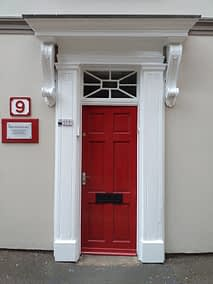 Baines-Ball & Associates red door with white surround